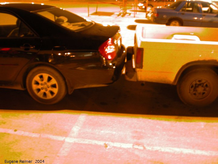 IMG 2004-Apr16 at St.Vital:  parking-lot car too close scam-artist