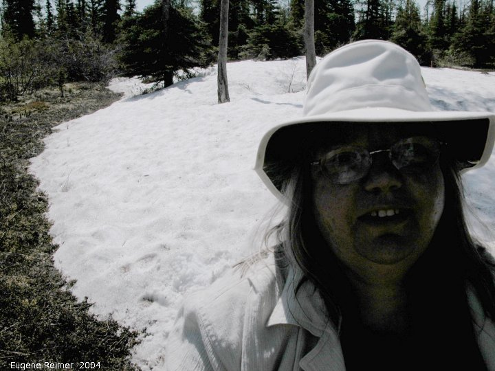 IMG 2004-Jul16 at hike near EastTwinLake:  snow-in-July Doris at snowbank underexposed