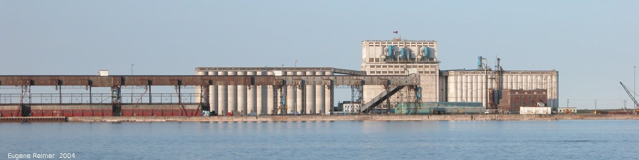 IMG 2004-Jul16 at the Wales & Whales Tour (FortPrinceOfWales+Beluga whaleWhales):  Churchill grain terminal from the bay