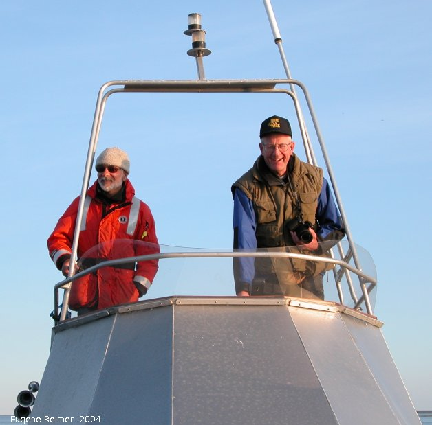 IMG 2004-Jul16 at the Wales & Whales Tour (FortPrinceOfWales+Beluga whaleWhales):  Captain Neufeld at the helm