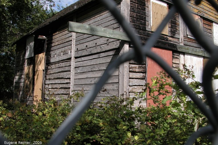 IMG 2006-Aug13 at the MNS walking-tour of PointDouglas:  Barber House historic site at 99 Euclid Av partially restored and slightly burned