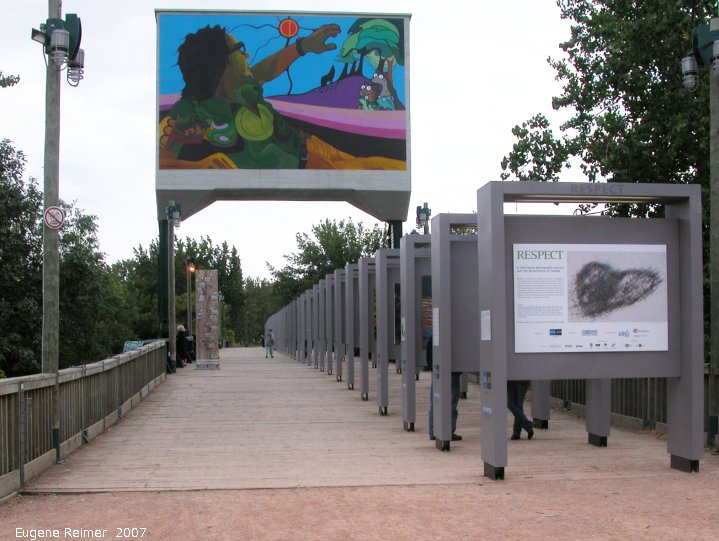 IMG 2007-Aug24 at the Forks:  RESPECT 72 images on 12-foot frames spanning the old railway-bridge