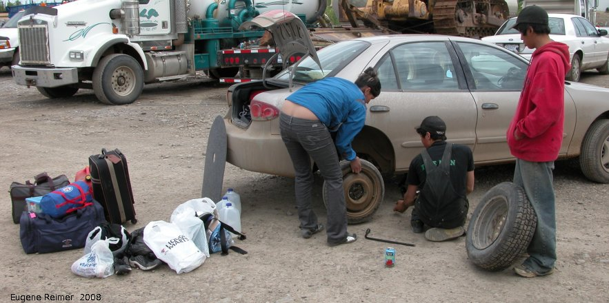 IMG 2008-Jul05 at FortMacpherson-NT:  car getting new tire installed
