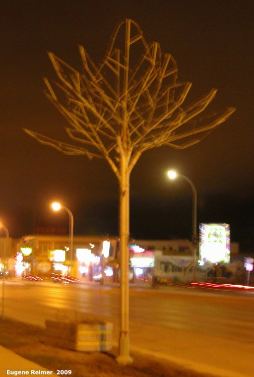 IMG 2009-May07 at Winnipeg MB:  artificial tree one of the 24-foot-high European-style galvanized-steel trees in St-James-Village Biz-zone